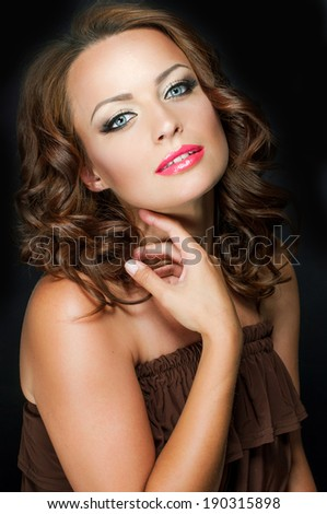Close-up portrait of young beautiful woman with pink sensual lips  - stock photo