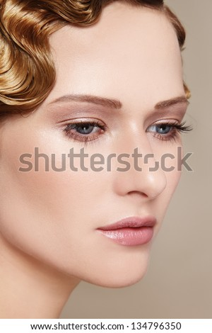 Close-up portrait of young beautiful woman with radiant skin - stock photo