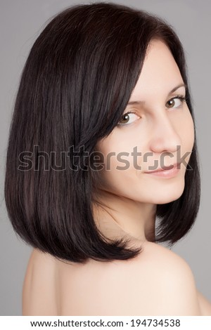 Close-up portrait of young beautiful woman with short hairstyle. Beautiful haircut. Short straight hair.