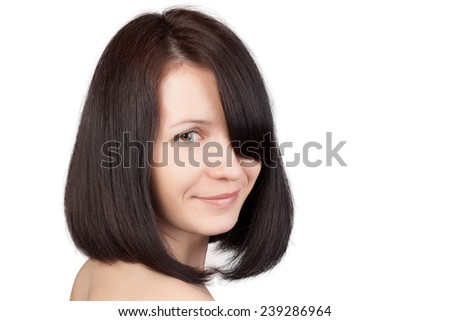 Close-up portrait of young beautiful woman with short hairstyle. Beautiful haircut. Short straight healthy hair. Skin care concept.