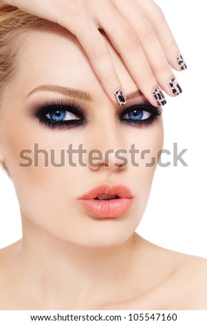 Close-up portrait of young beautiful woman with smoky eyes and fancy manicure, on white background - stock photo