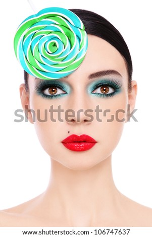Close-up portrait of young beautiful woman with stylish make-up and fancy lollipop hat