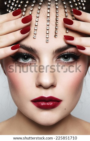 Close-up portrait of young beautiful woman with stylish make-up and manicure - stock photo