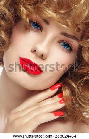Close-up portrait of young beautiful woman with stylish manicure and red lipstick over white background - stock photo