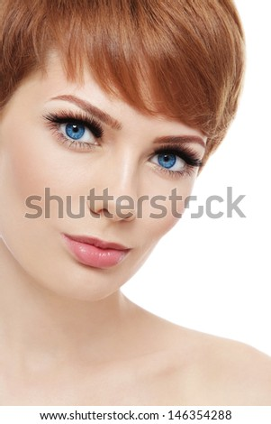 Close-up portrait of young beautiful woman with stylish short haircut over white background - stock photo