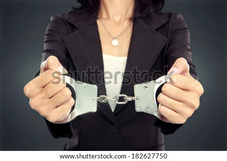close up portrait of Young business woman in handcuffs. crime concept - stock photo