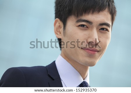 Close-up portrait of young businessman, China