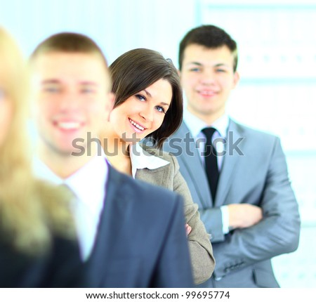 Close up portrait of young businesswoman with her colleagues on background - stock photo
