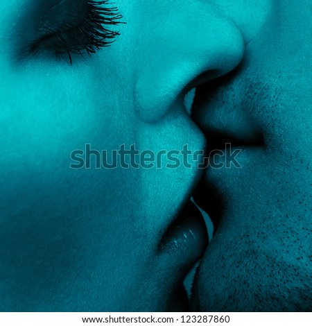 close up portrait of young caucasian couple kissing - stock photo