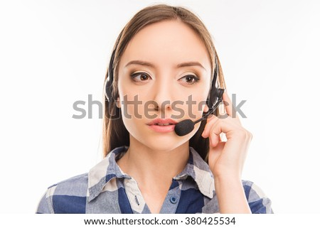 Close up portrait of young cheerful agent of call centre - stock photo