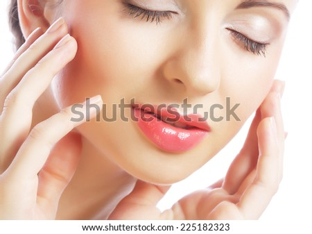 Close-up portrait of young closing eyes woman's face with clean fresh skin