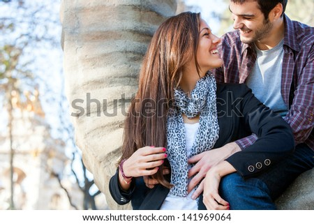 Close up portrait of young couple sharing quality time together in park. - stock photo