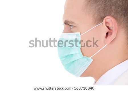 close up portrait of young doctor in mask isolated on white background - stock photo