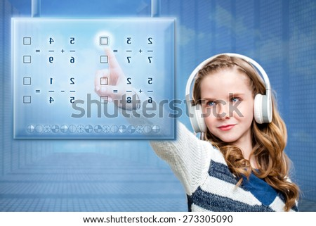 Close up portrait of young female student solving mathematical problem on futuristic digital screen. Conceptual portrait of girl touching screen against blue background. - stock photo