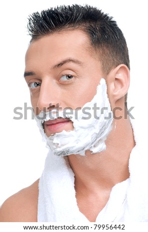 Close up portrait of young handsome man face with perfect skin in shaving foam.