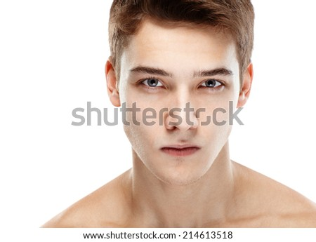 Close-up portrait of young handsome man looking at camera isolated on white background - stock photo