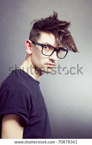 Close-up portrait of young male model with stylish hair