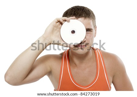 Close-up portrait of young man looking through the disk - stock photo
