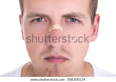 close up portrait of young man with adhesive tape over his nose - stock photo