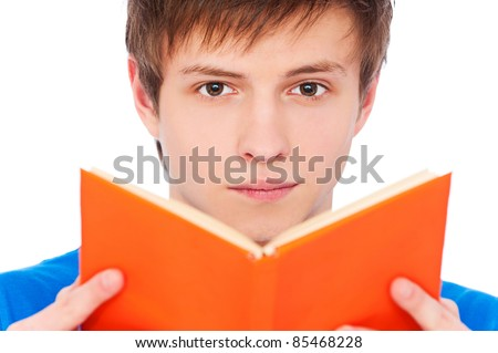 close-up portrait of young man with book over white background