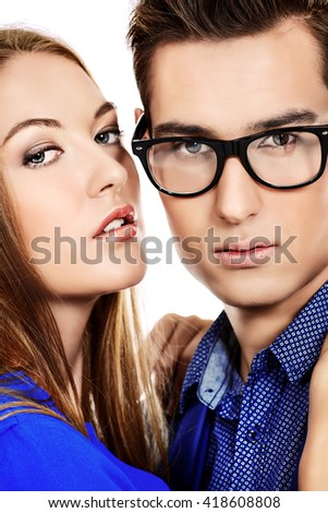 Close-up portrait of young passionate couple in love. Isolated over white background.