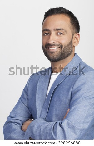 Close up portrait of young professional man on isolated white background. Election voter. - stock photo