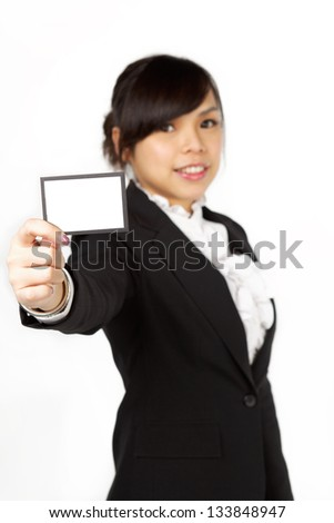 Close-up portrait of young smiling business woman holding credit card