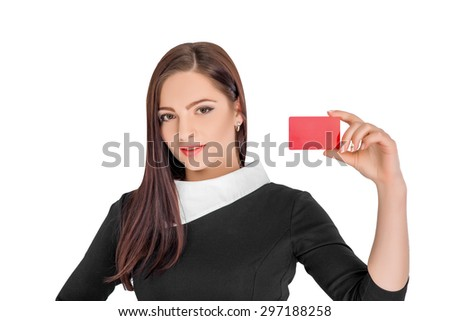 Close-up portrait of young smiling business woman holding red credit card isolated on white background - stock photo
