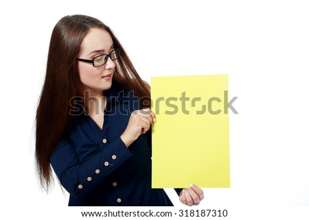 Close-up portrait of young smiling business woman holding yellow card isolated on white background