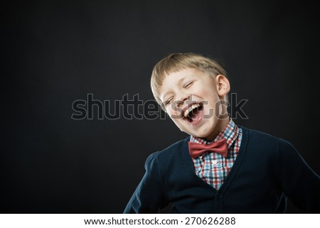Close up portrait of young smiling cute boy in black - stock photo