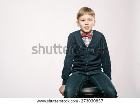 Close up portrait of young smiling cute boy on white background