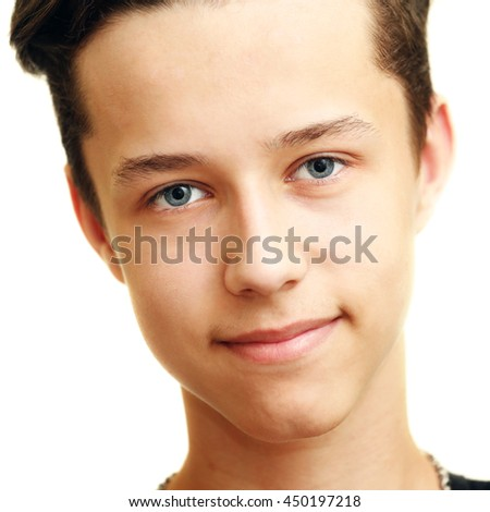Close up portrait of young smiling cute teenager, isolated on white - stock photo