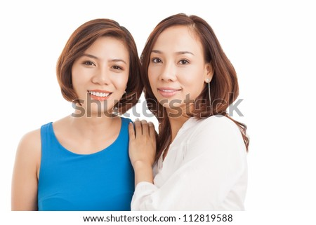 Close-up portrait of young Vietnamese women smiling at the viewer