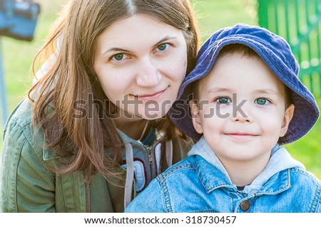 close up portrait of young woman and her boy child - family of mother and son