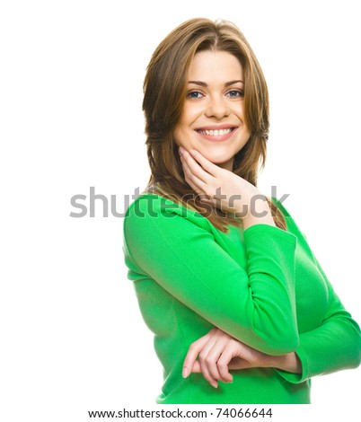 Close-up portrait of young woman casual portrait in positive view, big smile, beautiful model posing in studio over white background, green dressed . Isolated on white. - stock photo