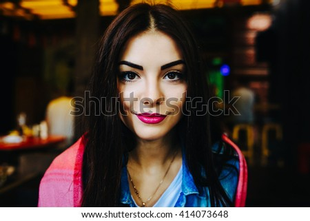 Close-up portrait of young woman face with clean fresh skin - close-up