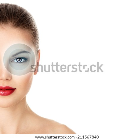 Close-up portrait of young woman face with virtual eye circuit, isolated over white background. Optic sight and abstract vision concept.  - stock photo