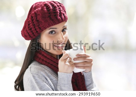 Close-up portrait of young woman holding tea cup - stock photo