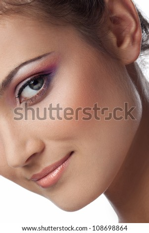 Close-up portrait of young woman on white background - stock photo