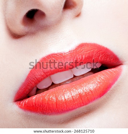 Close-up portrait of young woman's red lips  make up - stock photo