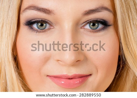 Close up portrait of young woman with beautiful eyes