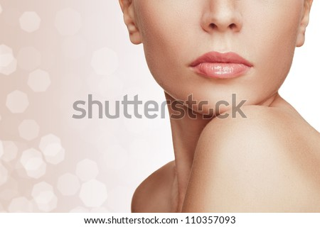 Close-up portrait of young woman with beautiful lips
