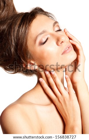 Close-up portrait of young woman with her eyes closed and hands near her face.Picture ideal for face&skin care products commercial