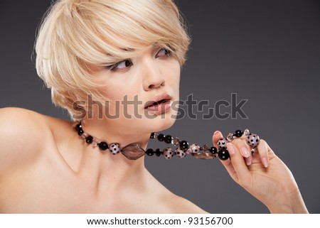 Close up Portrait of young woman with jewelry