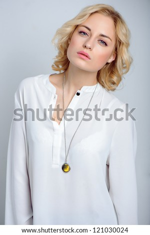 close up portrait sexy blond women on gray background - stock photo