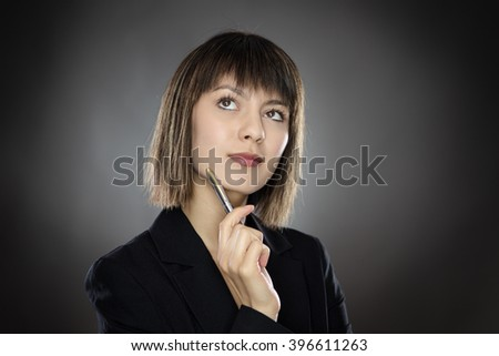 close up portrait shot of young successful business woman looking pensive.
