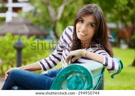 Close up portrait smiling asian female model at the outdoor - stock photo