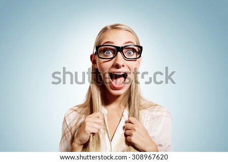 Close up portrait young blonde business woman, looking shocked, surprised in full disbelief isolated blue background. Positive human emotions, facial expressions, feeling, attitude, reaction - stock photo