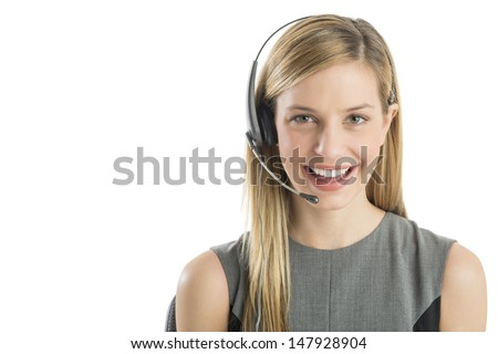 Close-up portrait young female customer service representative wearing headset smiling against white background - stock photo