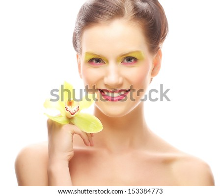 Close up portrait young woman with bright make up holding orchid
